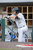 Kevan Smith (32) of the Charlotte Knights waits for his turn to bat during the game against the Durham Bulls at BB&T BallPark on July 22, 2015 in Charlotte, North Carolina.  The Knights defeated the Bulls 6-4.  (Brian Westerholt/Four Seam Images)