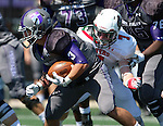 SIOUX FALLS, SD - SEPTEMBER 6: Nephi Garcia #3 from the University of Sioux Falls looks for room past Mitchell Matthias #7 from Minot State in the second quarter of their game Saturday afternoon at Bob Young Field in Sioux Falls.  (Photo by Dave Eggen/Inertia)