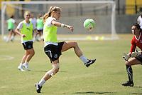 Allison Falk takes a shot as goalkeeper Erin McLeod defends during the Women's Professional Soccer (WPS) All-Star practice at KSU Stadium in Kennesaw, GA, on June 29, 2010.