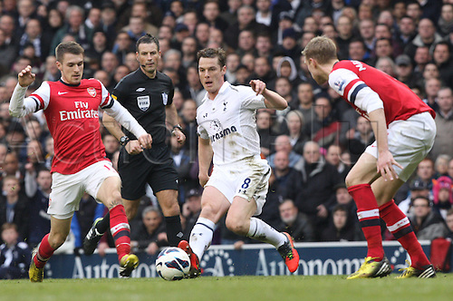 03.03.2013. London, England. Scott Parker of Tottenham Hotspur plays the ball between Per Mertesacker and Aaron Ramsey during the Premier League game between Tottenham Hotspur and Arsenal from White Hart Lane