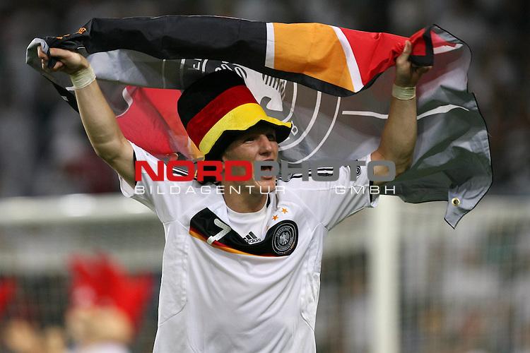 UEFA Euro 2008 Semi-Finals Match 29 Basel - St. Jakob-Park. Deutschland ( GER ) - T&uuml;rkei ( TUR ) 3:2 ( 1:1 ). <br /> Bastian Schweinsteiger ( Germany / Mittelfeldspieler / Midfielder / Bayern Muenchen #07 ) jubelt nach dem Sieg mit Deutschlandflagge und Hut.<br /> Foto &copy; nph (  nordphoto  )