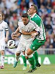 Real Madrid's Mesut Ozil (l) and Betis' Antonio Amaya during La Liga match.April 20,2013. (ALTERPHOTOS/Acero)