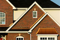 Close up photograph of the copper details on the roof portions of a luxury custom home built by Kings Court Builders in the Stonehaven subdivision Naperville, IL.