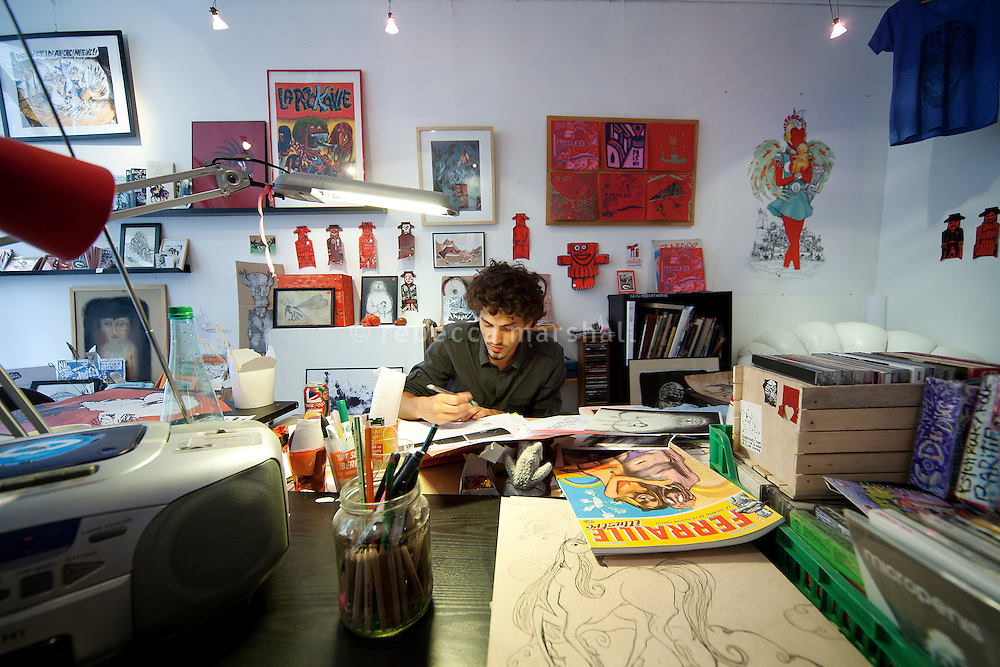 Tom Romarin, animator, at work on a drawing at 'En Traits Libres' gallery and workshop, Montpellier, France, 14 July 2012. 'En Traits Libres' is a collective of 11 local artists, animators and comic book illustrators.