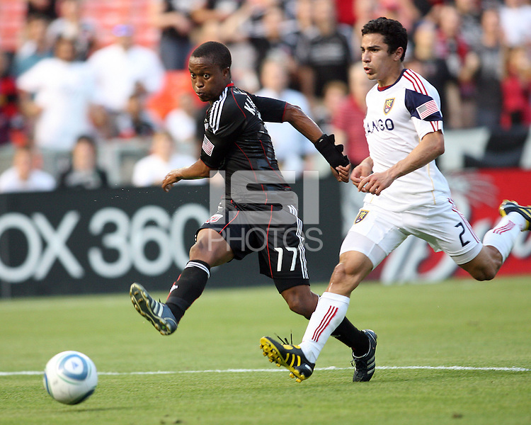 Boyzzz Khumalo #17 of D.C. United takes a shot as Tony Beltran #2  of Real Salt Lake moves in during an Open Cup match at RFK Stadium, on June 2 2010 in Washington DC. DC United won 2-1.