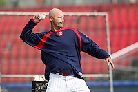 Reading Phillies manager Dusty Wathan throws batting practice before a game against the New Hampshire Fisher Cats at FirstEnergy Stadium on April 10, 2012 in Reading, Pennsylvania.  New Hampshire defeated Reading 3-2.  (Mike Janes/Four Seam Images)