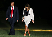 United States President Donald J. Trump walks across the South Lawn from Marine One with First Lady Melania Trump, after returning to the White House on August 24, 2018 in Washington, D.C.President Trump traveled to Columbus, Ohio.<br /> Credit: Oliver Contreras / Pool via CNP