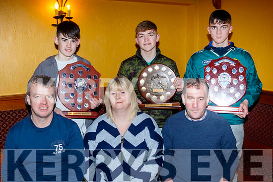 Seated L-R Colm Horgan, juvenile chairman, Cara Flahive, secretary and Jer Slattery, club chairman, back L-r Jordan Goggin with the U14 North Kerry Champions Shield, Nathan Gueran, U15 Tom Healy shield and Ciaran Casey with the U16 County League shield at the club juvenile awards in the White Sands hotel, Ballyheigue last Sunday afternoon.