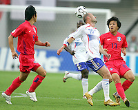 Zinedine Zidane (10) of France heads away from Ho Lee (17) of the Korea Republic.The Korea Republic and France played to a 1-1 tie in their FIFA World Cup Group G match at the Zentralstadion, Leipzig, Germany, June 18, 2006.