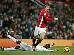 Manchester United's Zlatan Ibrahimovic tussles with Sunderland's Papy Dijlobodji during the Premier League match at Old Trafford Stadium, London. Picture date December 26th, 2016 Pic David Klein/Sportimage