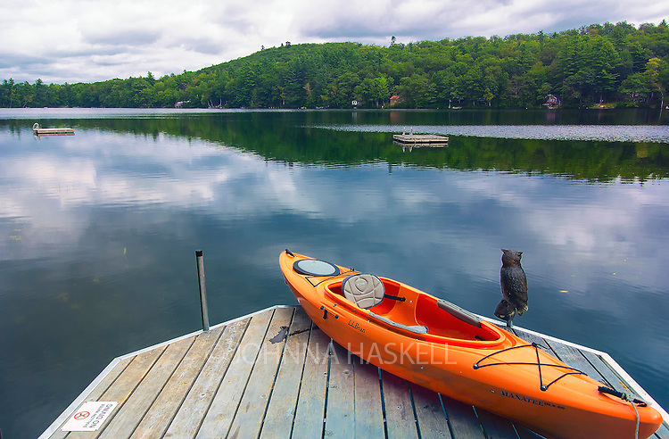 Sand pond outside of Farmington Maine showing the beautiful calm reflective waters for kayaking.