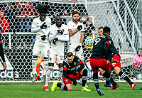 WASHINGTON, DC - FEBRUARY 29: Ola Kamara #9 of DC United blasts a free kick at Lalas Abubakar #6 , Kei Kamara #23, and Drew Moor #3 of the Colorado Rapids during a game between Colorado Rapids and D.C. United at Audi Field on February 29, 2020 in Washington, DC.