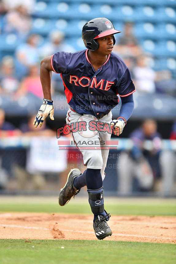 Rome Braves left fielder Justin Ellison (5) runs to first base during a game against the Asheville Tourists at McCormick Field on June 25, 2017 in Asheville, North Carolina. The Braves defeated the Tourists 7-2. (Tony Farlow/Four Seam Images)