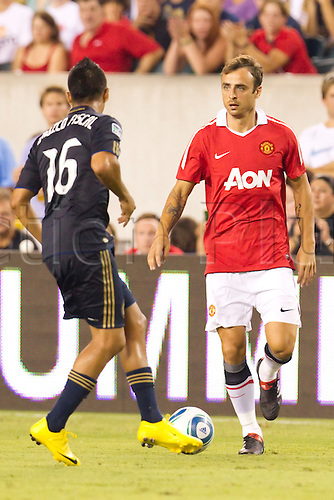 July 21, 2010: Manchester United forward Dimitar Berbatov (9) looks to make his move on Philadelphia Union defenseman Michael Orozco Fiscal (16) during the international friendly match between Manchester United and the Philadelphia Union at Lincoln Financial Field in Philadelphia, Pennsylvania.  The Manchester United beat the Philadelphia Union, 1-0.