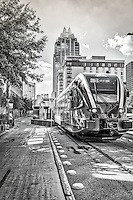 This is the Metro Rail in a almost black and white version of the Metro Rail as it leave downtown Austin.