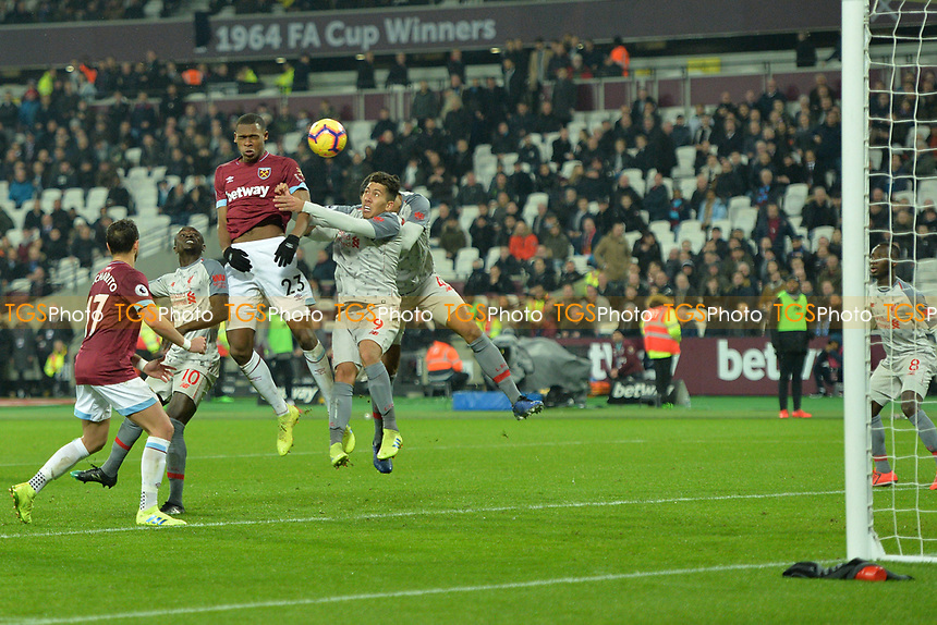 Issa Diop of West Ham United heads wide during West Ham United vs Liverpool, Premier League Football at The London Stadium on 4th February 2019