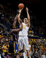 David Kravish of California shoots the ball during the game against Coppin State at Haas Pavilion in Berkeley, California on November 8th, 2013.    California defeated Coppin State, 83-64.