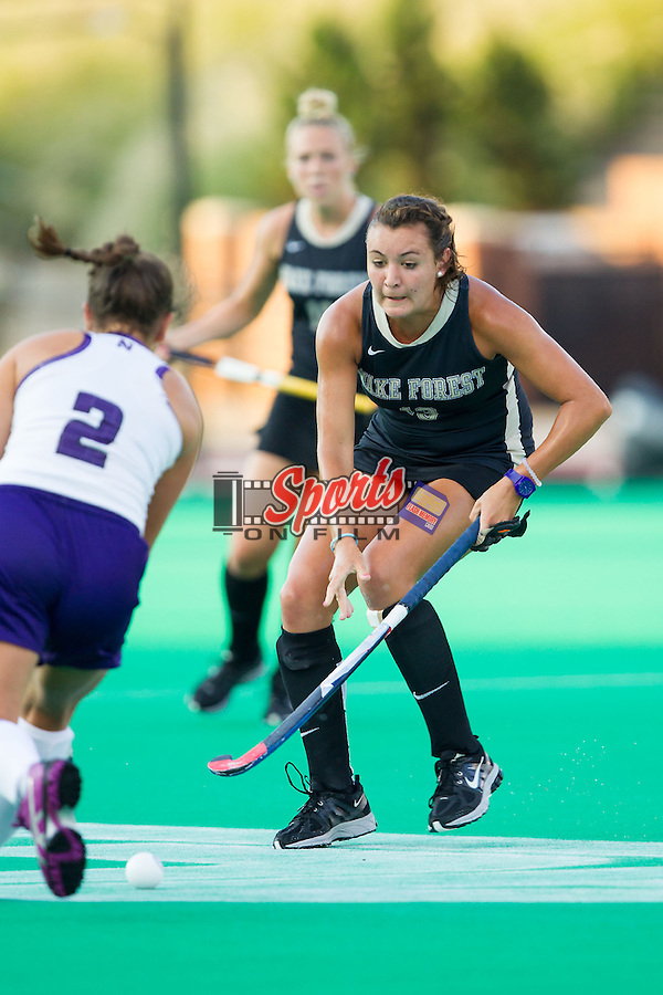 Karlee Spirit (13) of the Wake Forest Demon Deacons plays defends against Kelsey Gradwohl (2) of the Northwestern Wildcats during first half action at Kentner Stadium on September 11, 2014 in Winston-Salem, North Carolina.  The Demon Deacons defeated the Wildcats 1-0.  (Brian Westerholt / Sports On Film)