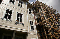 Restored Ottoman wooden house with scaffolding and restoration alongside in the Suleymaniye district, Istanbul, Turkey