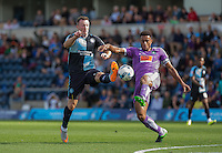 Garry Thompson of Wycombe Wanderers & Curtis Nelson of Plymouth Argyle battle for the ball during the Sky Bet League 2 match between Wycombe Wanderers and Plymouth Argyle at Adams Park, High Wycombe, England on 12 September 2015. Photo by Andy Rowland.