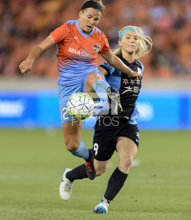Houston Texas - Amber Brooks (12) of the Houston Dash gains control of a loose ball in the second half against the Chicago Red Stars Julie Johnston (8) on Saturday, April 16, 2016 at BBVA Compass Stadium in Houston Texas.  The Houston Dash defeated the Chicago Red Stars 3-1.