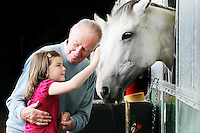 6/8/2010. Sophie Bradshaw aged 5 from Stepaside and her grandfather Bernard Sawier are pictured looking at the horses at the Failte Ireland RDS House Show. Picture James Horan/Collins