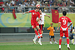 10 August 2008: Cui Peng (CHN) (12) wins a header over Sepp De Roover (BEL) (2).  The men's Olympic soccer team of Belgium defeated the men's Olympic soccer team of China 2-0 at Shenyang Olympic Sports Center Wulihe Stadium in Shenyang, China in a Group C round-robin match in the Men's Olympic Football competition.