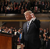 US President Donald J. Trump arrives to deliver his first address to a joint session of Congress from the floor of the House of Representatives in Washington, DC, USA, 28 February 2017.  Traditionally the first address to a joint session of Congress by a newly-elected president is not referred to as a State of the Union.<br /> Credit: Jim LoScalzo / Pool via CNP