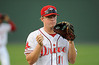 Third baseman Keaton Briscoe (11) of the Greenville Drive before a game against the Lexington Legends on Monday, August 19, 2013, at Fluor Field at the West End in Greenville, South Carolina. Lexington won, 5-1. (Tom Priddy/Four Seam Images)