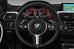 Car pictures of steering wheel view of a 2016 BMW 3 Series M Sport 5 Door Wagon Steering Wheel