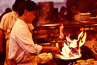 Chef Roy Yamaguchi with flaming pan at his restaurant in Hawaii Kai, Oahu