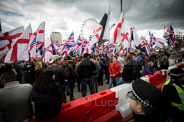 Britain First.<br /> <br /> London, 01/04/2016. Today, two British far-right extremist groups, Britain First and the EDL (English Defence League), held two separate marches and rallies in reaction to the recent Westminster terror attack in a 'designated area' between Trafalgar Square, Whitehall and Victoria Embankment. A counter-demonstration was called by the Anti-Fascist Network, London Antifascists and Unite Against Fascism (UAF) to oppose the extremist right-wing racist rhetoric and exploitation of the attack by attributing responsibility to Muslim communities and migrants. A heavy riot police presence (with the aid of a helicopter, police horses and dogs) was in the area trying to keep the three factions separated: the EDL in a Whitehall pub and Britain First moved directly to the Embankment. The situation for the anti-fascist groups was different, while they were trying to march from Trafalgar Square to their designated area in Embankment close to the Ministry of Defence HQ, police imposed Section 14 (As explained in a Police information leaflet called: &quot;Police Information UAF Protest&quot; - see IMG_4859), arresting and taking away several left-wing activists. The anti-fascist rally was decimated by this police tactic, leaving a very small counter rally to confront the two extreme right-wing groups. <br /> <br /> To read Section 14 - Public Order Act 1986 please read the PDF attached at the end of this story or click here: http://www.legislation.gov.uk/ukpga/1986/64