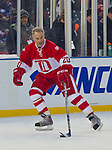 31 December 2013: Former Detroit Red Wings forward Mickey Redmond (20) skates with the puck, without helmet, during the Toronto Maple Leafs v Detroit Red Wings Alumni Showdown hockey game, at Comerica Park, in Detroit, MI.