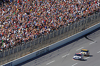 Apr 26, 2009; Talladega, AL, USA; Fans cheer as NASCAR Sprint Cup Series driver Dale Earnhardt Jr (88) leads Jeff Burton (31) during the Aarons 499 at Talladega Superspeedway. Mandatory Credit: Mark J. Rebilas-