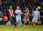 Leon Clarke of Sheffield Utd and Darron Gibson of Sunderland during the Championship match at Bramall Lane Stadium, Sheffield. Picture date 26th December 2017. Picture credit should read: Simon Bellis/Sportimage