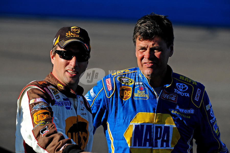 Nov. 7, 2008; Avondale, AZ, USA; NASCAR Sprint Cup Series driver Michael Waltrip (right) with teammate David Reutimann during qualifying for the Checker Auto Parts 500 at Phoenix International Raceway. Mandatory Credit: Mark J. Rebilas-