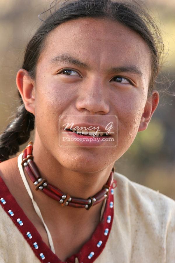 A Native American teenage Indian boy smiling