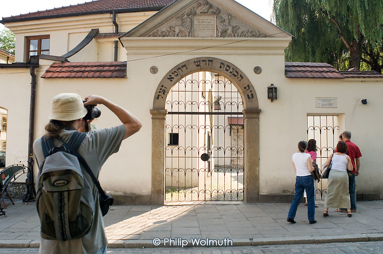 Tourists at the Remuh Synagogue, which still serves the tiny and elderly Jewish community still living in Kazimierz, the pre-Second World War Jewish district of Krakow.