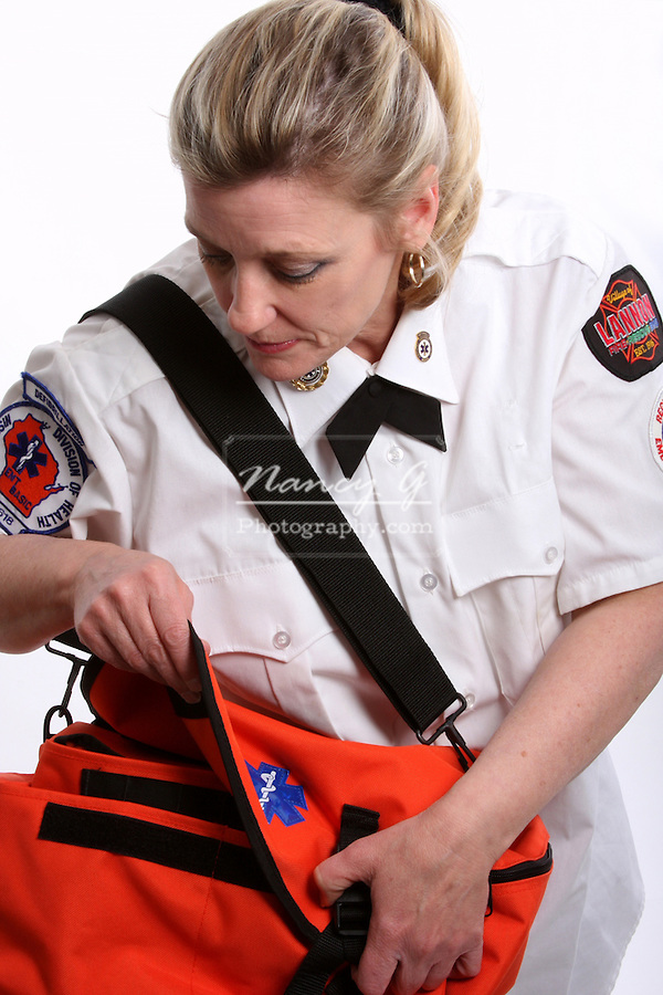 A Wisconsin EMT looking into a medical bag