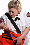 A Wisconsin EMT looking into a medical bag