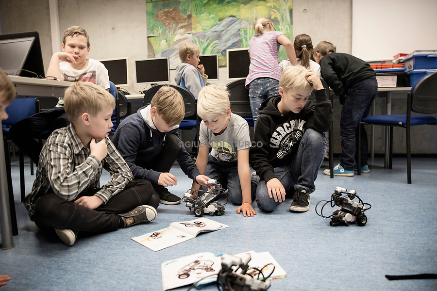 Pelgulinna Gümnaasium IT-Arendusjuht, Children in a coding and robotic class in an elementary school in tallinn<br /><br />Estonia is arguably the most advanced country in the world when it comes to use of the Internet and related technologies. Estonia is a most improbable success, in that a mere quarter of a century ago it was still under domination of the Soviet Union as a very poor backwater on the Baltic Sea. Now it is a developed country and a member of both the EU and NATO. In late 2014, Estonia became the first country in the world to offer digital residency to non-Estonians living anywhere in the world. Non-residents can obtain an Estonian smart ID card which enables them to have access to many electronic services available to Estonian citizens, including the ability to create and operate an Estonian company. <br /> @Giulio Di Sturco