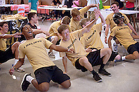 NWA Democrat-Gazette/BEN GOFF &bull; @NWABENGOFF<br /> Andrew Thompkins (from left), Dylan Chincher and the rest of the Men in Black dance on Monday Aug. 17, 2015 as the group recruits freshman to join The Jungle at the club fair during Tiger Camp freshman orientation day at Bentonville High School. The Men in Black are seniors who lead The Jungle student section at athletic events.