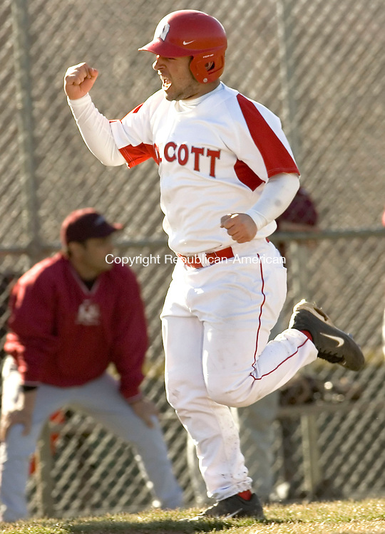 WOLCOTT, CT- 19 APRIL 2007-041907JS02-Wolcott's Nick Negretti celebrates as he scores from first on a triple by Kyle Cleary to tie the score during their game against Naugatuck Thursday at Wolcott High School.-- --Jim Shannon / Republican-American
