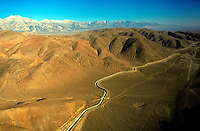The Los Angeles Aqueduct winds past the Alabama Hills in the desert below the Western Sierras in Inyo County California. Resources, Environment, Water, Mountains, Desert. Lone Pine California USA Inyo County, Eureka Valley.