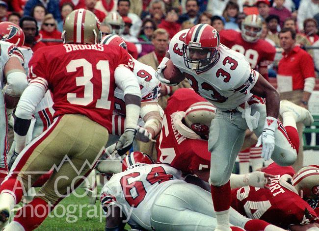 San Francisco 49ers vs Atlanta Falcons at Candlestick Park Sunday, November 12, 1989..49ers beat Falcons 45-3.Atlanta running back Gene Lang (33) ..