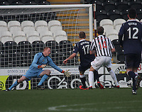 Sam Morrow scores past Craig Samson in the St Mirren v Ross County Clydesdale Bank Scottish Premier League match played at St Mirren Park, Paisley on 19.1.13.