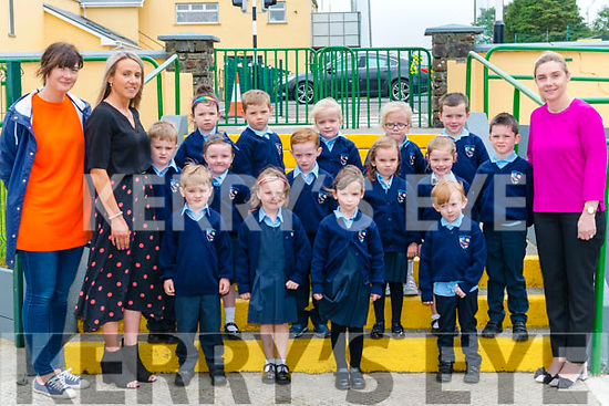 First day of school for Junior Infants front l-r Michael Fleming, Emma Fitzgerald, Meabh Oliver, Ryan O'Connor,  centre l-r Daniel O'Keeffe, Audrey O'Leary, Luke Curtin,<br /> Alannah Herlihy, Ciara Knee, Nathan Cronin, back l-r Lily Mai O'Sullivan, Przemek Potoczek, Ava and Ellie Brosnan, Ronan O'Neill pictured with Elaine O'Donovan SNA, Mary V O'Leary Teacher and Geraldine Shanahan Principal at the Gneeveguilla National School last Monday.