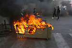 Lebanese protesters anti-Government set garbage bins on fire and block the majority of the main roads, during a protest over deteriorating living conditions, in Beirut, Lebanon,1 July 2020. Lebanon has been seing months of protests against the current government fueled by the dire state of the domestic economy. Many citizens fear that the combination of rising unemployment, poverty, sectarian tensions, the devaluation of the Lebanese pound and the ongoing pandemic of the COVID-19 disease may spark another violent conflict, three decades after the end of the Middle Eastern nation's devastating civil war. Photo by Marwan Tahtah
