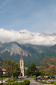 Bad Ragaz, Switzerland. The Evangelical Church, with cloud-covered mountains behind.