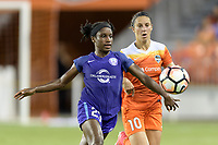 Houston, TX - Saturday June 17, 2017: Jasmyne Spencer keeps Carli Lloyd away from the ball during a regular season National Women's Soccer League (NWSL) match between the Houston Dash and the Orlando Pride at BBVA Compass Stadium.